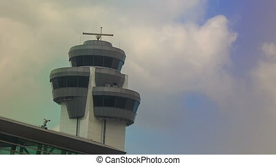 Control Tower Radar by Airport Terminal Building against Sky