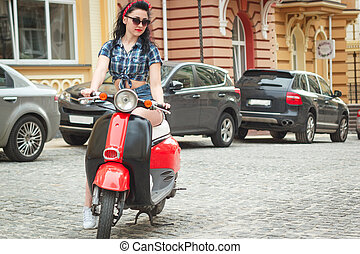 young woman on a retro scooter