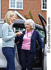 Female Neighbor Giving Senior Woman A Lift In Car