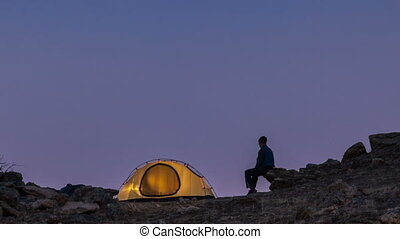 Moonrise above the tourist tent. Time-lapse. - Moonrise in...