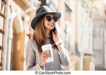 Modern young woman in a big city - Keeping in touch Smiling...