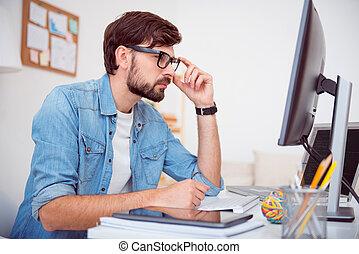 Man looking at screen of computer