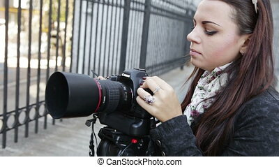 Photographer shooting on nature - A photographer prepares a...