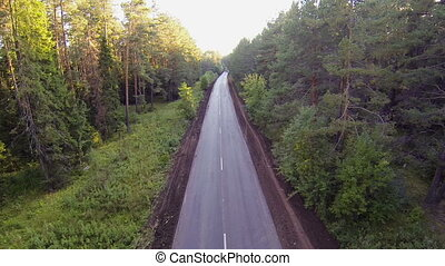 cars on the road in the forest, aerial view. aerial view...