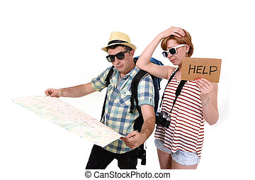 young tourist couple reading city map looking lost and...