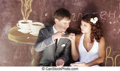 Young family drinking coffee - Young family in wedding dress...