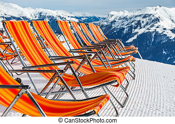 Ski resort deckchairs - Photo of empty red deckchairs on the...