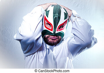 Frustrated, angry businessman with Mexican wrestler mask, expressions of anger and rage