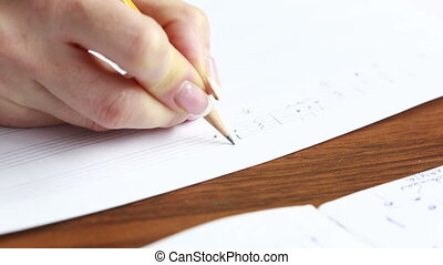 Hand with pencil and music sheet. composer writes music -...