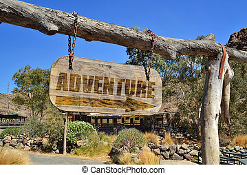 "old wood signboard with arrow and text ""adventure..."