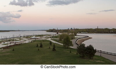 View of the city park strelka in Yaroslavl located along the Volga river embankment day to night timelapse hyperlapse