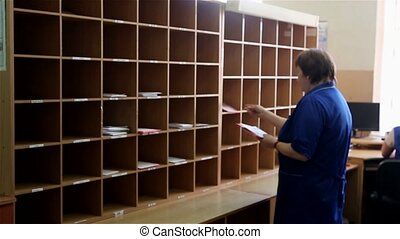Woman sorts letters