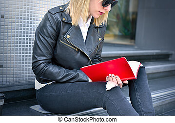 hipster girl reading book - young hipster girl reading a red...