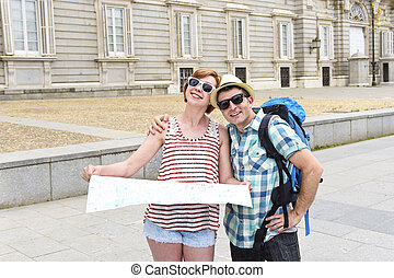 young tourist friends couple visiting Madrid in Spain...
