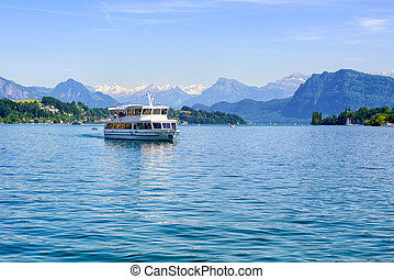 Cruise ship in front of Alps mountains peaks on Lake Lucerne, Switzerland