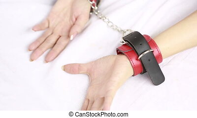 female hands in leather handcuffs sex toys - female hands in...