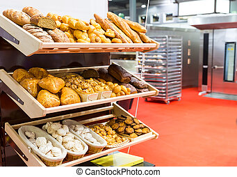 Loaves of bread and buns on the shelves