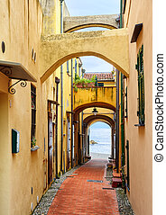 Narrow street leading to the Mediterranean Sea in old town...