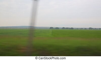 Journey through the country - Looking at field from a fast...