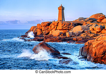 Lighthouse of Ploumanach on Cote de Granite Rose, Brittany,...