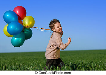 Child with balloons - Happy child with balloons running on...