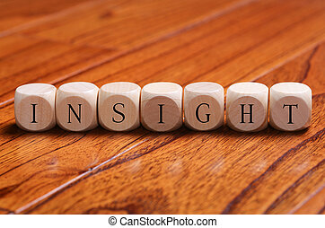 INSIGHT Word Concept - INSIGHT word wooden blocks are on the...