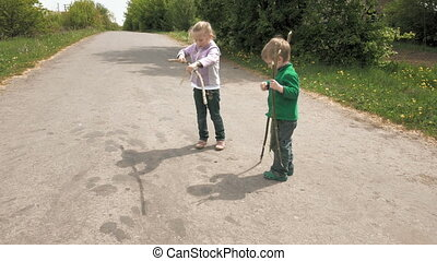 Little children plays with bug beetle on the road - Happy...