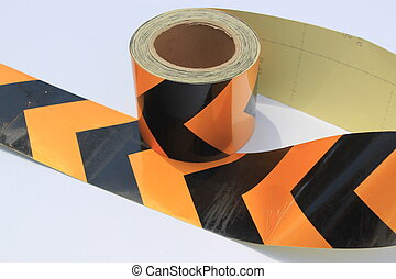 Roll of yellow and black hazard tap