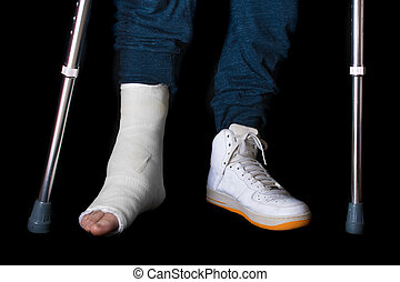 Young man with a broken ankle and a leg cast - Young man...
