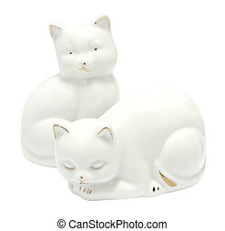 Kitsch white porcelain kitten figurines isolated on white background