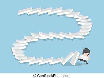 Businessman escaping from falling dominos, domino effect,...