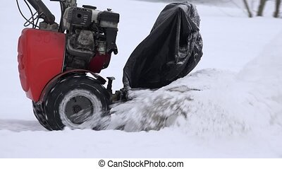 Snow removal with snow blower equipment from sidewalk in...