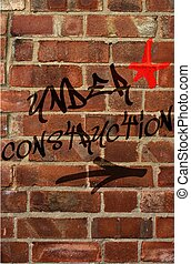 Under Construction - Under construction grafitti on brick...