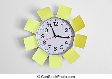 Clock and Adhesive Note close up