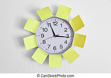 Clock and Adhesive Note close up