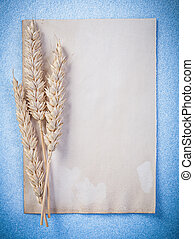 Rye ears vintage blank paper sheet on blue background...