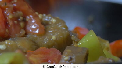 Mixing stewing vegetables in the pan - Close-up shot of...