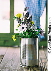 Tin can with flowers