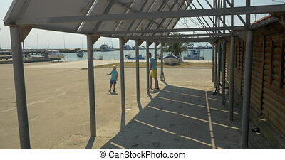 Dad and child playing outdoor by the solar panel - Boy and...