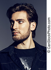 mens hairstyle - Portrait of a handsome young man. Men's...