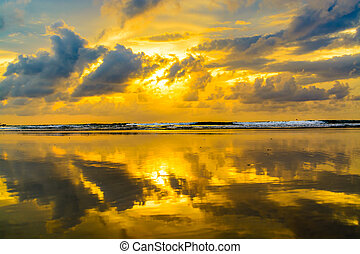 Sunset reflection at the beach