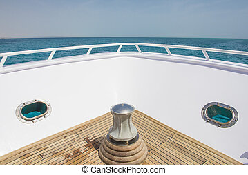 View from the bow of a luxury yacht over tropical sea - View...