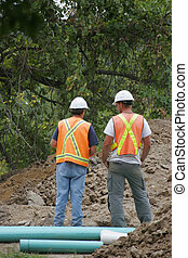 Construction Managers - Project Managers assess site view...