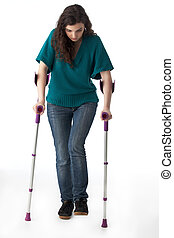 girl with crutches isolated on white