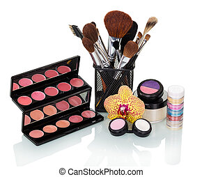 Cosmetic brush, eyeshadow, blush, lip gloss and orchid...