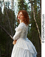 woman the mystical forest - Young woman in white long dress...