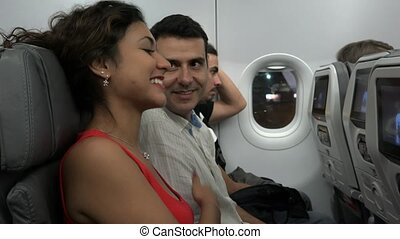 Passengers Talking On Airplane