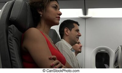 Airline Passengers Waiting On Airplane