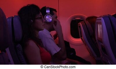 Passengers On Plane With Turbulance