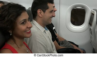Passengers Laughing On Airplane